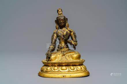 A Sino-Tibetan inlaid gilt copper alloy figure of a White Tara, 18/19th C.
