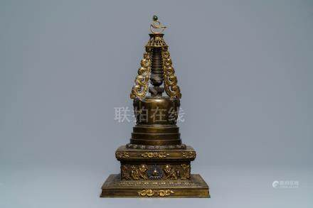 A large parcel-gilt inlaid bronze stupa, Tibet, 18th C.