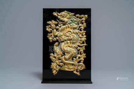 A gilt and polychromed copper repoussé torana 'dragon' fragment, Tibet, 17/18th C.