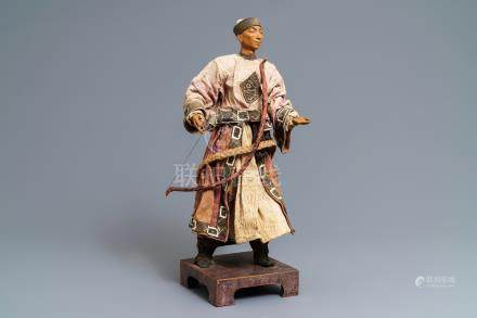 A Chinese Manchu archer doll in painted wood and textile, 19th C.