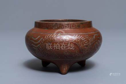 A Chinese silver inlaid bronze incense burner, Xuande mark, 19th C.