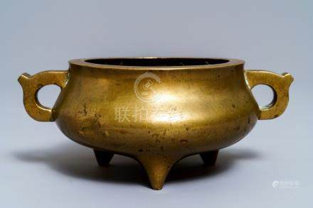 A Chinese bronze tripod censer, Qianlong mark, 19th C.