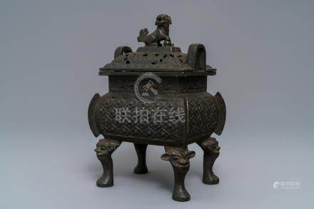 A large Chinese bronze incense burner and cover, Ming