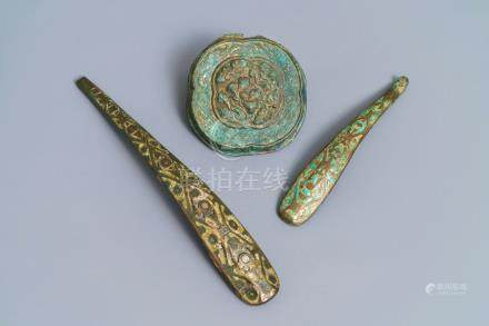 Two Chinese inlaid bronze belt hooks and a bronze ornament, Zhou or Han