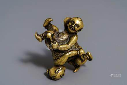 A Chinese gilt bronze Hoho brothers scroll weight, 18/19th C.