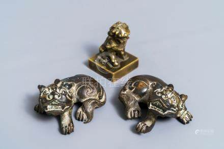A pair of Chinese bronze 'lion' scroll weights and a seal, Ming and 18th C.