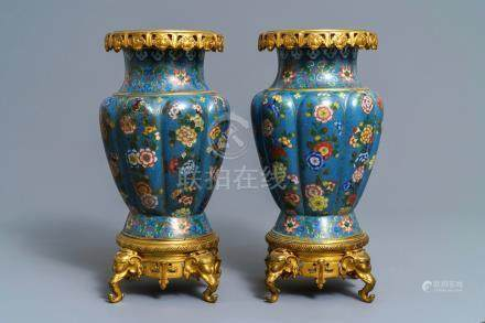 A pair of Chinese gilt bronze mounted cloisonné vases, 19th C.