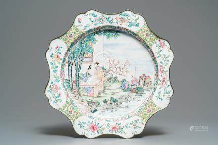 A large Chinese Canton enamel charger with figures in a garden, Yongzheng