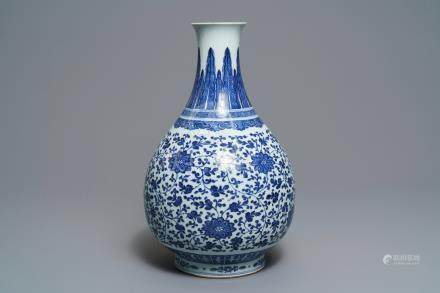A Chinese blue and white 'peony scroll' bottle vase, Qianlong