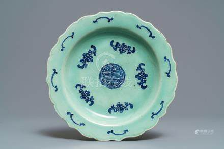 A Chinese blue and white celadon 'bats and shou' dish, Qianlong mark and prob. of the period