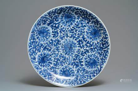 A large Chinese blue and white lotus scroll dish, Kangxi