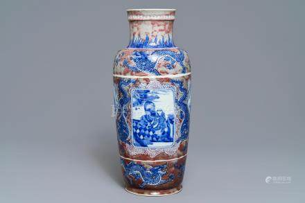 A rare Chinese blue, white and underglaze red rouleau vase, Kangxi