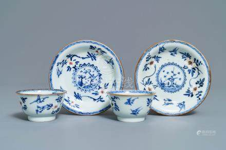 A pair of Chinese blue, white and underglaze red cups and saucers, Kangxi