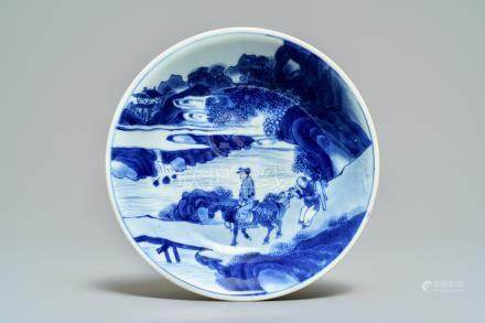 A Chinese blue and white plate with travellers in a landscape, Kangxi mark and of the period