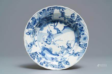 A Chinese blue and white deep plate with fighting warriors on horseback, Kangxi mark and of the period