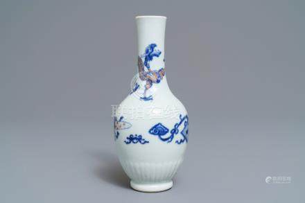 A Chinese blue, white and underglaze red 'dragon' vase, Kangxi