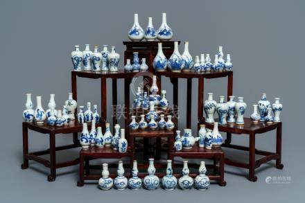 An impressive collection of 66 Chinese blue and white miniature vases, Kangxi