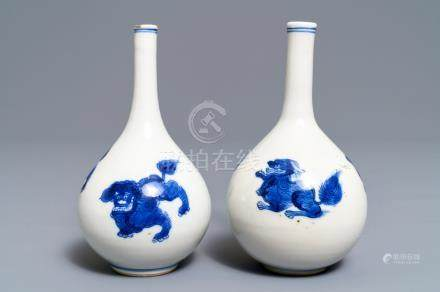 A pair of Chinese blue and white bottle vases with qilins, Kangxi