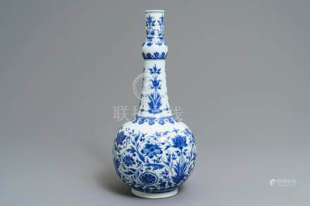 A Chinese blue and white bottle vase with floral design, Transitional period