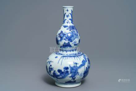 A Chinese blue and white double gourd vase, Transitional period