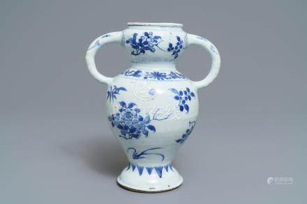 A Chinese blue and white elephant-handled vase with floral design, Transitional period