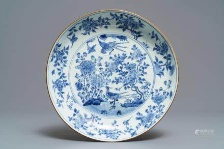 A Chinese blue and white dish with birds among blossoms, Transitional period