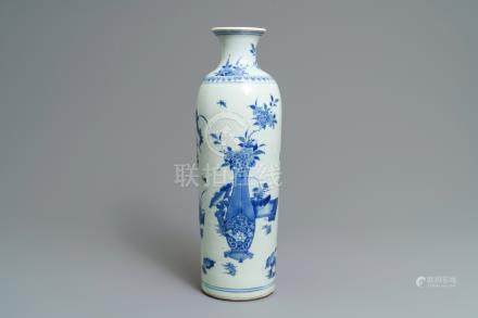 A large Chinese blue and white rouleau vase with flower vases, Transitional period