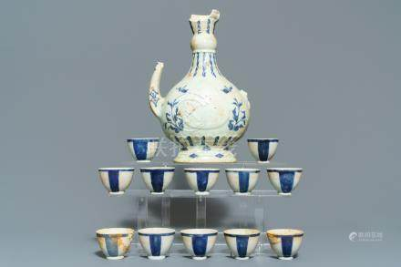 A Chinese shipwreck blue and white Islamic market 'aftaba' ewer and twelve cups, Transitional period