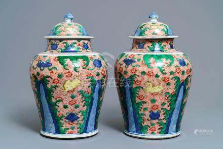 A pair of Chinese wucai 'galloping horses' vases and covers, Transitional period