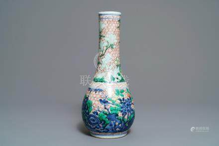 A Chinese wucai bottle vase with birds in a garden, Transitional period