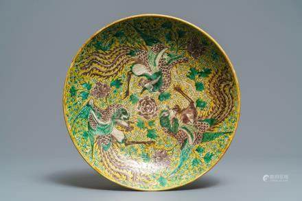 A Chinese green, yellow and aubergine-glazed biscuit 'phoenixes' dish, He He Jia Chan mark, Transitional period