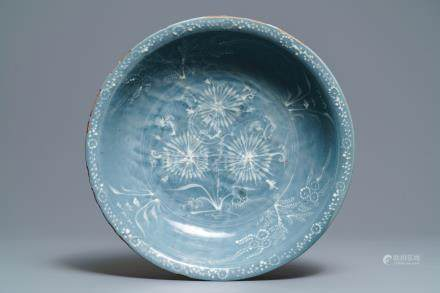 A Chinese Swatow celadon slip-decorated blue-ground dish, Ming