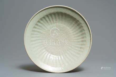 A Chinese Swatow celadon slip-decorated dish, Ming