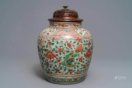 A Chinese polychrome Swatow jar with Buddhist lions among peony scrolls, Ming