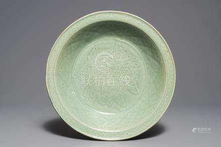 A Chinese Longquan celadon dish with underglaze design of peonies, Ming