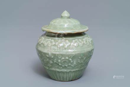 A small Chinese Longquan celadon vase and cover with underglaze design, Ming