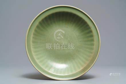 A Chinese Longquan celadon dish with underglaze design, Ming