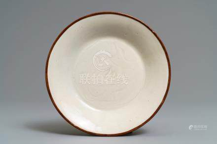 A Chinese dingyao carved 'ducks' plate, probably Song