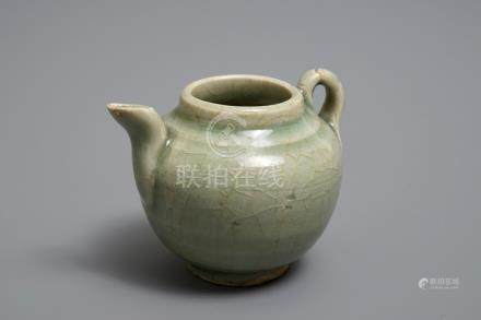 A Chinese celadon teapot or ewer, Song/Yuan