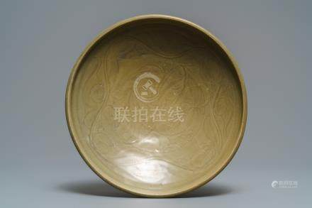 A Chinese Yaozhou celadon bowl with incised floral design, Song