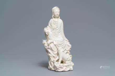 A Chinese Dehua blanc de Chine group of Guanyin with a tiger, 18/19th C.