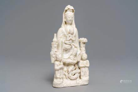 A Chinese Dehua blanc de Chine 'Guanyin with children 'group, Kangxi