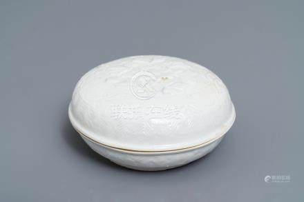 A Chinese Dehua blanc de Chine relief-decorated box and cover, incised mark, Kangxi