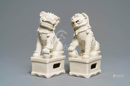 A pair of large Chinese Dehua blanc de Chine models of buddhist lions, Kangxi