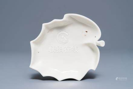 A Chinese Dehua blanc de Chine leaf-shaped brush washer, Kangxi