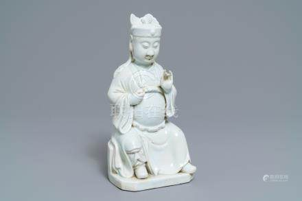 A Chinese blanc de Chine figure of Guandi, 18/19th C.