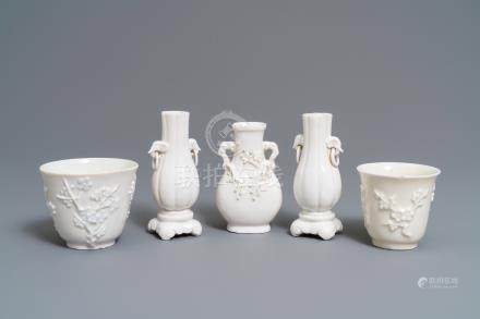 Three Chinese blanc de Chine vases and two cups with applied designs, Kangxi and later