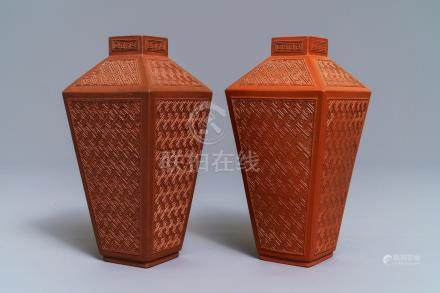 A pair of Chinese Yixing stoneware relief-decorated tea caddies, seal mark, 18th C.