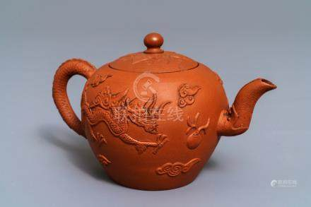 A Chinese Yixing stoneware teapot with applied dragons, Kangxi