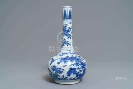 A Chinese blue and white bottle vase with birds in a landscape, Wanli